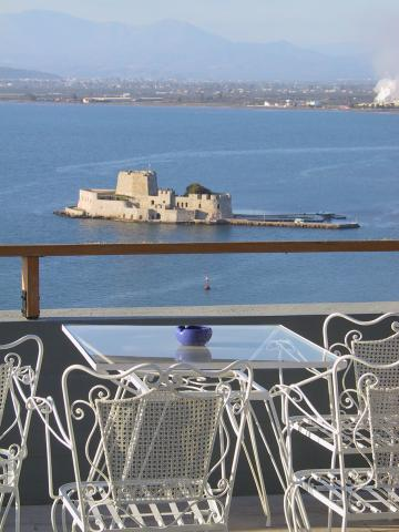 Chairs overlooking a castle in the Nauplion bay