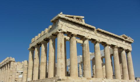 Blue sky behind the classic columns of the Parthenon