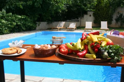 Cooking ingredients on a table by the pool
