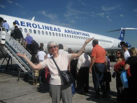 Jane smiles as she boards a plane in Argentina.