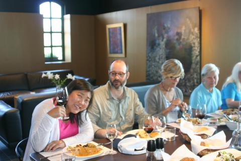 Cheers at a great meal planned by Hellenic Adventures